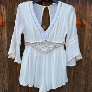 A'gaci white deep-V romper with 3/4 bell sleeves